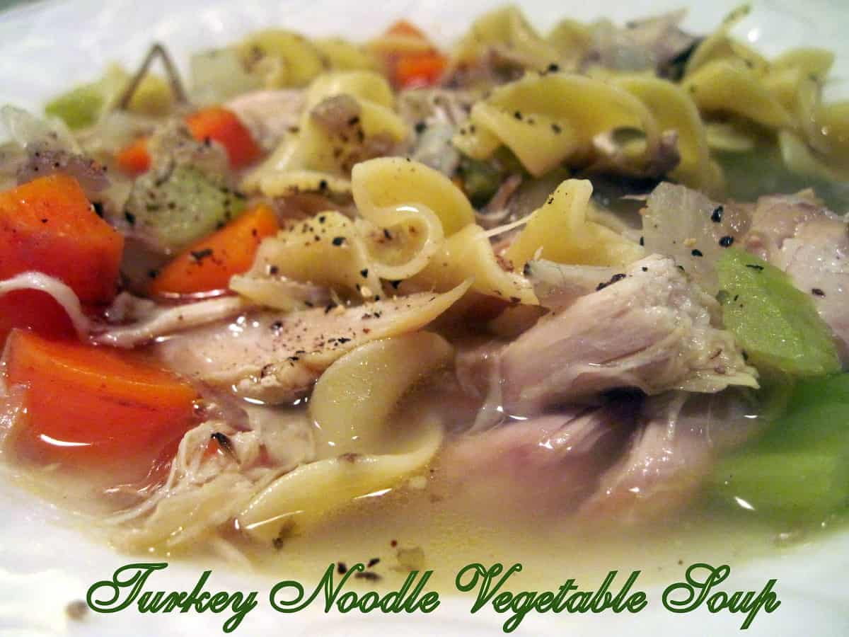 Tender chunks of leftover turkey, carrots, onions, celery, and noodles are simmered in delicious homemade turkey stock. #mooreorlesscooking #soup #turkeyvegsoup #turkeynoodlevegsoup via @Mooreorlesscook