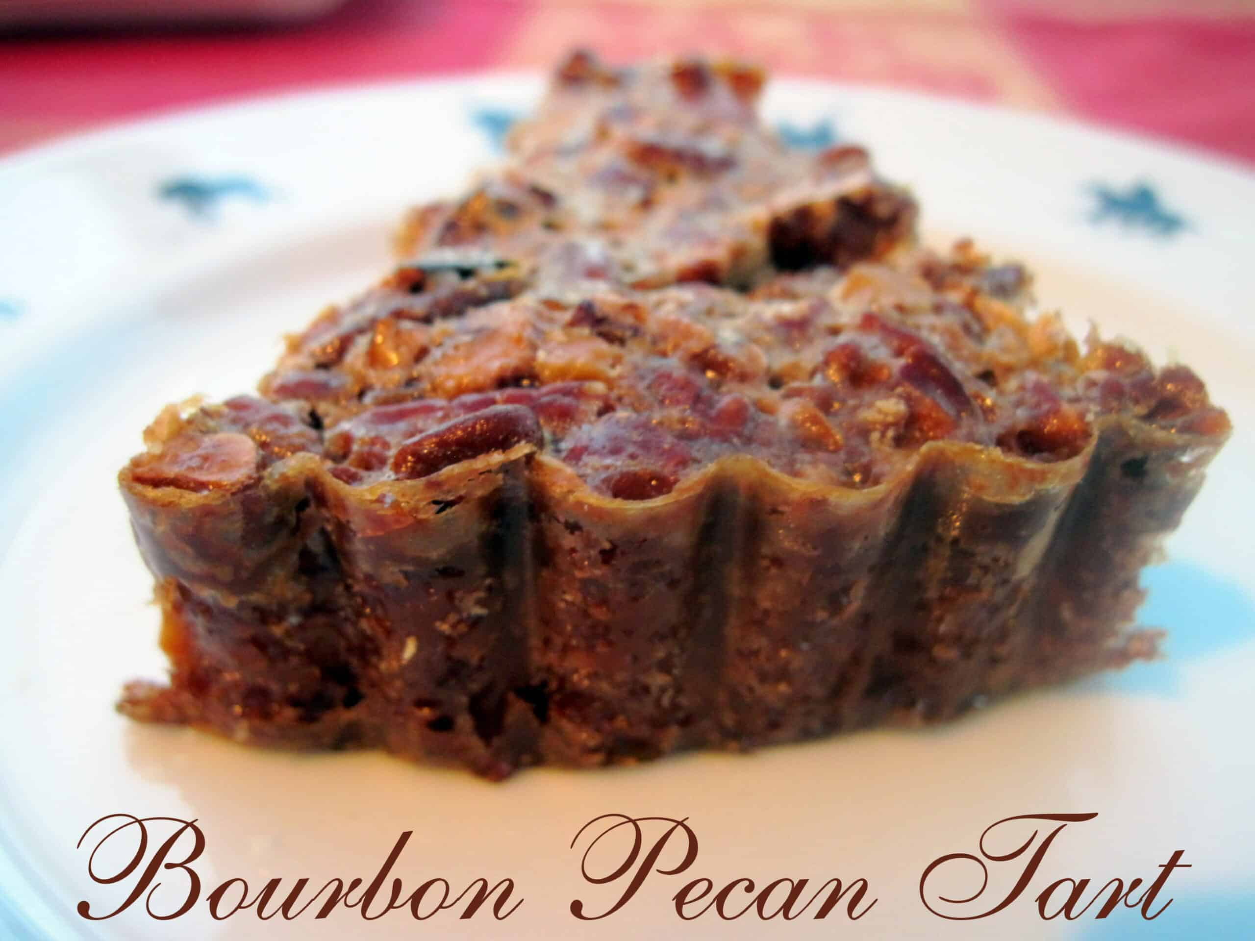 Best Pecan Bourbon Tart~ Heavenly and delicious Pecan Bourbon Tart. Simple ingredients make this tart a popular dessert for the holidays or any day. via @Mooreorlesscook