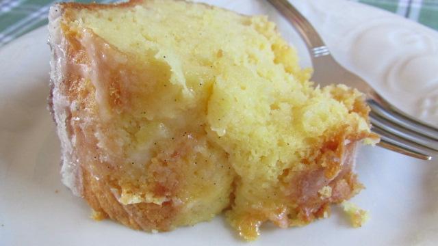 Pineapple Bundt Poke Cake slice of cake and fork on white plate