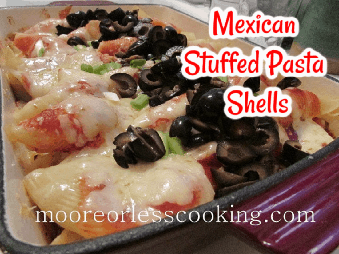 A delicious comforting Mexican Stuffed Pasta Shell Casserole. Served with Green Onions, Black Olives, Sour Cream, and Cholula Sauce. Make it in under an hour. Perfect for a Cinco de Mayo party or just for your family. Everyone will love it! via @Mooreorlesscook