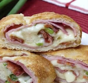 sliced stromboli filled with bacon ham and cheese
