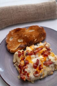 Plate with casserole garlic toast and napkin
