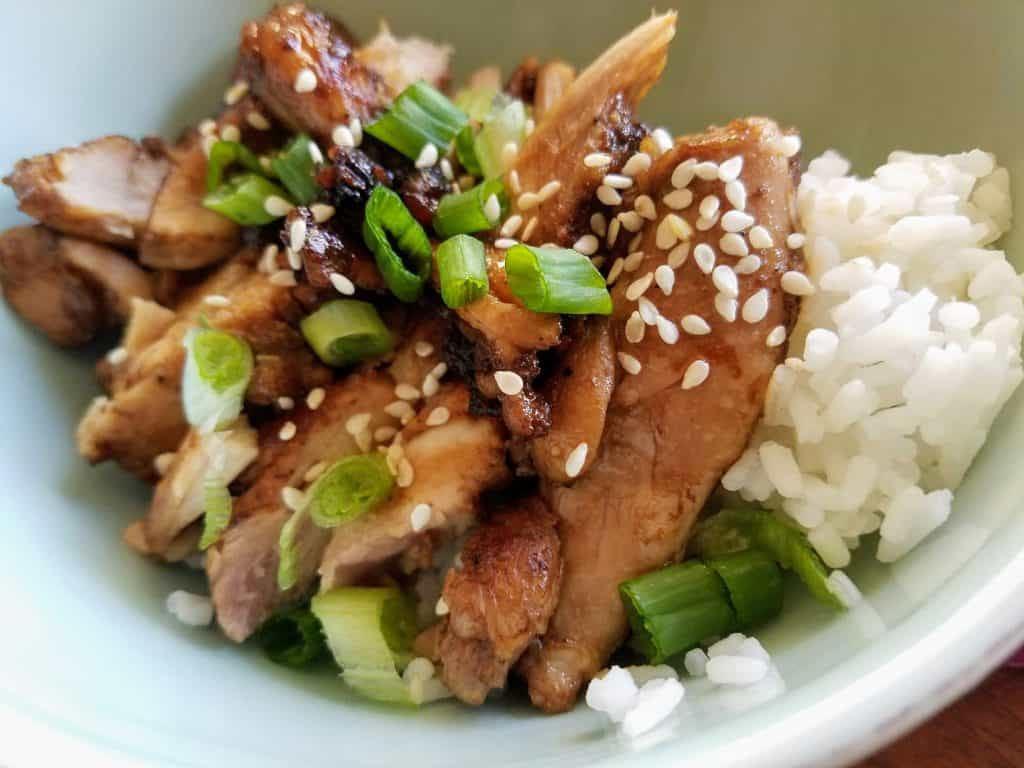 tender juicy slices of marinated chicken served over rice