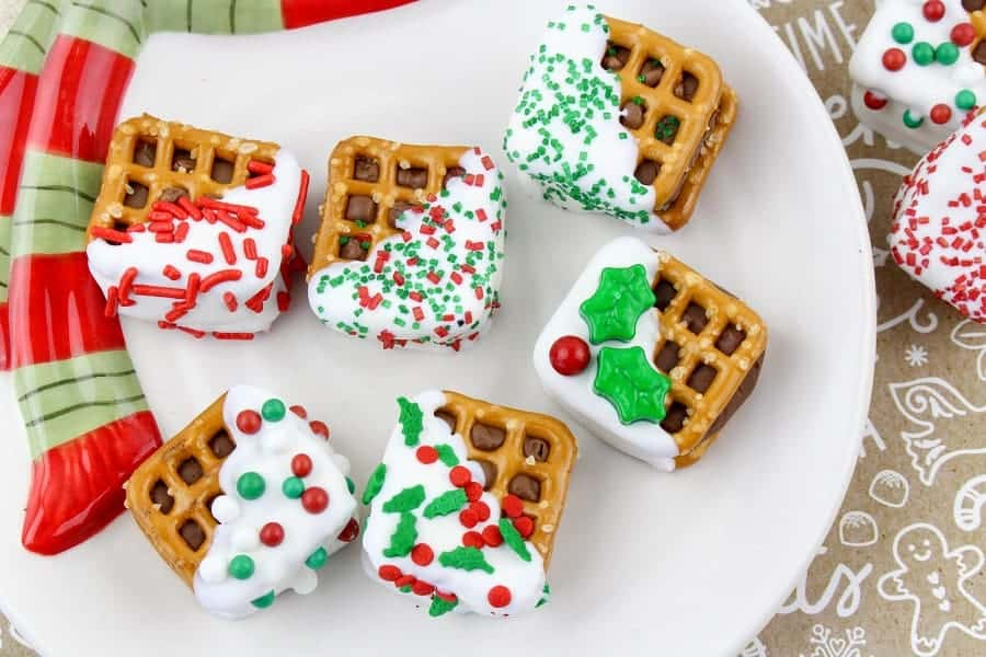 Christmas Chocolate Pretzel Sandwiches are so pretty and delicious to eat! These are super cute and easy to make!! Everyone will love the candy bar surprise in the middle!! Great to place in baggies and give them to your neighbors, co-workers, teachers, friends, and family!! via @Mooreorlesscook