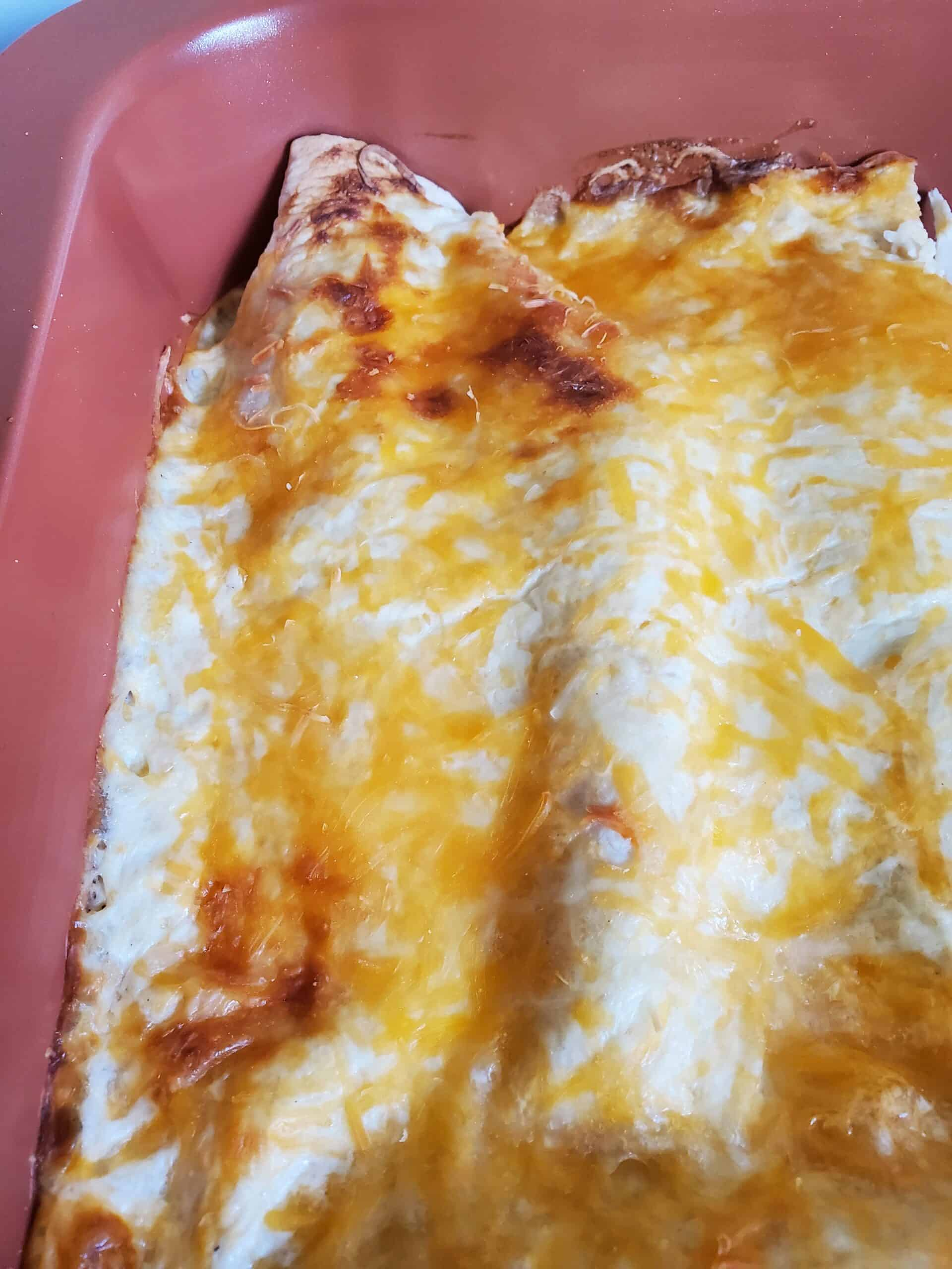 #ad @HpHood Sour Cream Chicken Enchiladas~ Creamy chicken and cheese enchiladas with a flavorful sour cream white sauce is a simple and delicious meal that comes together quickly. #TouchOfHood #IC #mooreorlesscooking #enchiladas #sourcream via @Mooreorlesscook