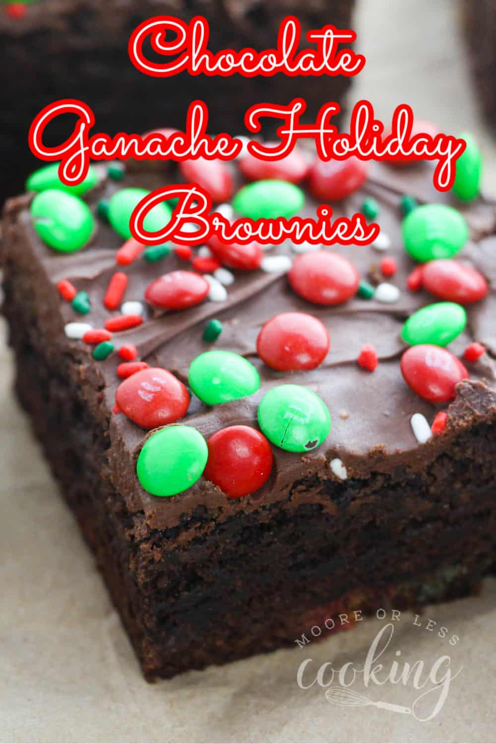 The Best fudge-y and incredibly moist Christmas Brownies covered in a smooth and silky chocolate ganache and Red and Green M&M's! via @Mooreorlesscook
