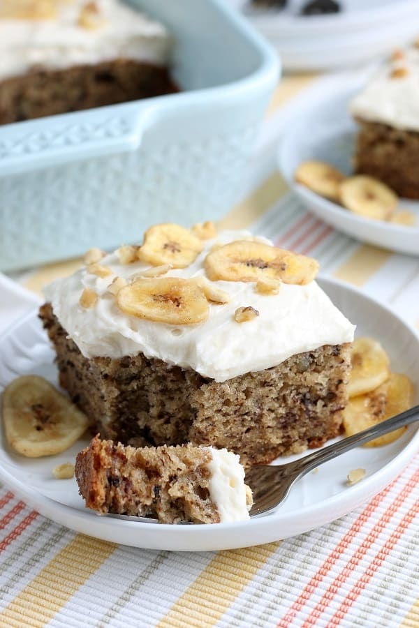The Best Banana Walnut Cake is topped with a thick and creamy cream cheese frosting. It's baked up perfectly in a 13 x 9 baking dish with the best banana flavor, that is so soft & moist, and just crazy delicious. Optional garnish with sliced fresh bananas or banana chips and chopped walnuts for an amazing dessert! via @Mooreorlesscook