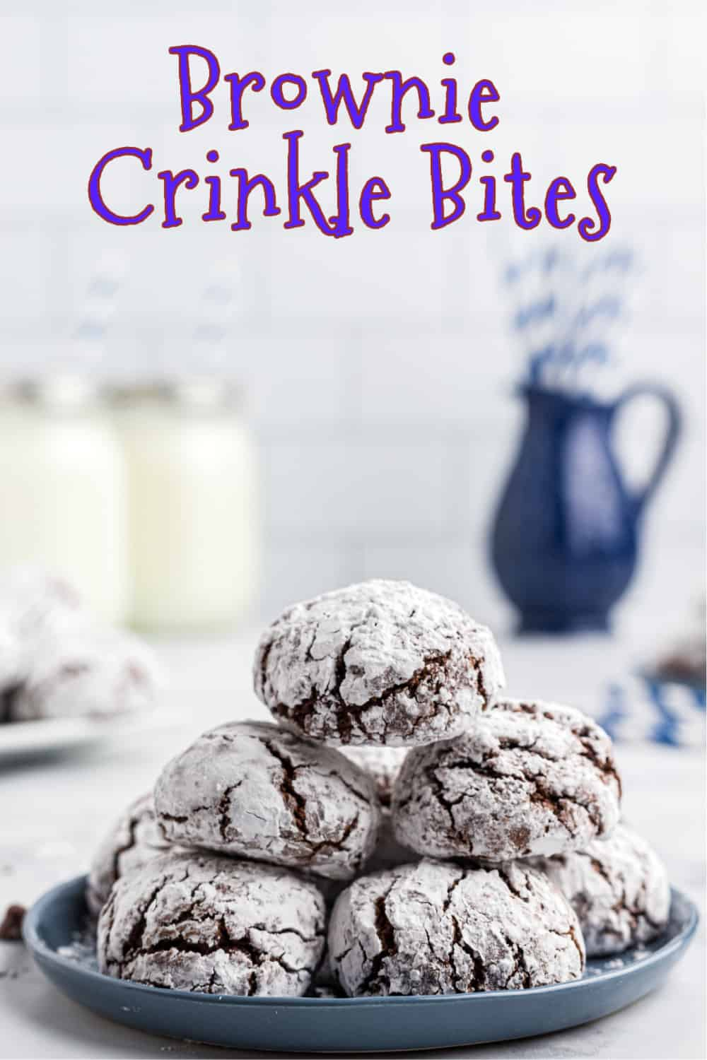 Fudgy, chocolate brownie crinkle bites are a decadent treat for the holidays. Part cookie and part brownie, these rich and chewy bites are rolled in powdered sugar to produce their iconic crinkle on top when baked. via @Mooreorlesscook