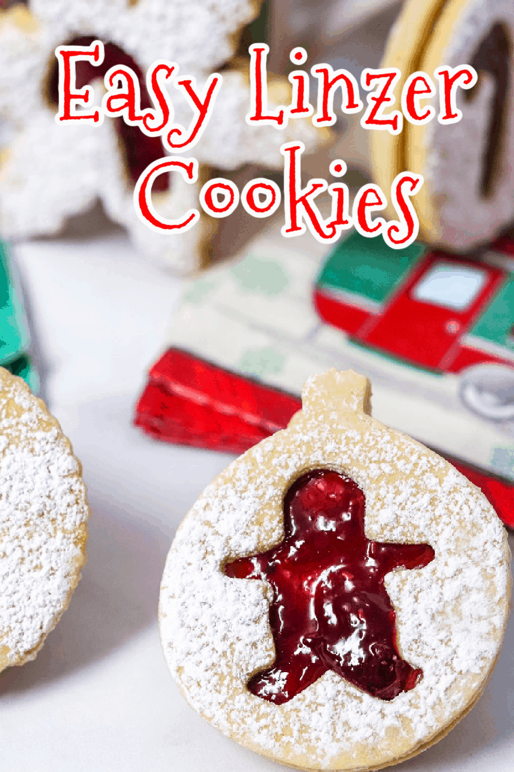 These buttery shortbread Linzer cookies are filled with raspberry jam that peeks through the cutout on top of each cookie. Dusted with powdered sugar, these sandwich cookies make the perfect holiday sweet treat. So easy to make with only a few ingredients! Get those cookie cutters out! via @Mooreorlesscook