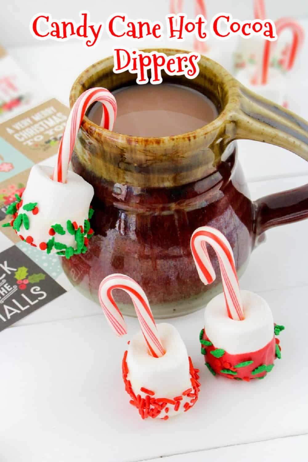 These jolly Candy Cane Hot Cocoa Dippers are a festive way to add marshmallows to hot chocolate. They're a fun way to melt a sweet and creamy marshmallow and to add a touch of peppermint to your hot cocoa. via @Mooreorlesscook