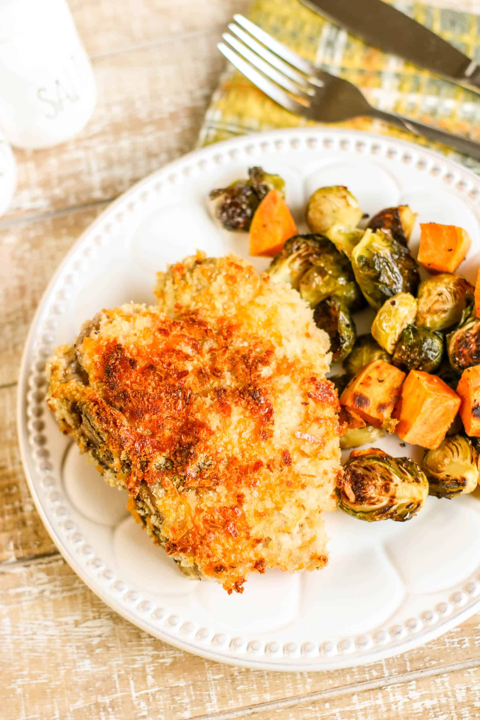 If you're looking for a complete meal baked together on one pan, this Sheet Pan Crispy Cheddar Pork Chops with Brussels Sprouts and Sweet Potatoes is it! Crispy on the outside and juicy on the inside, you'll love this method of cooking pork chops. via @Mooreorlesscook