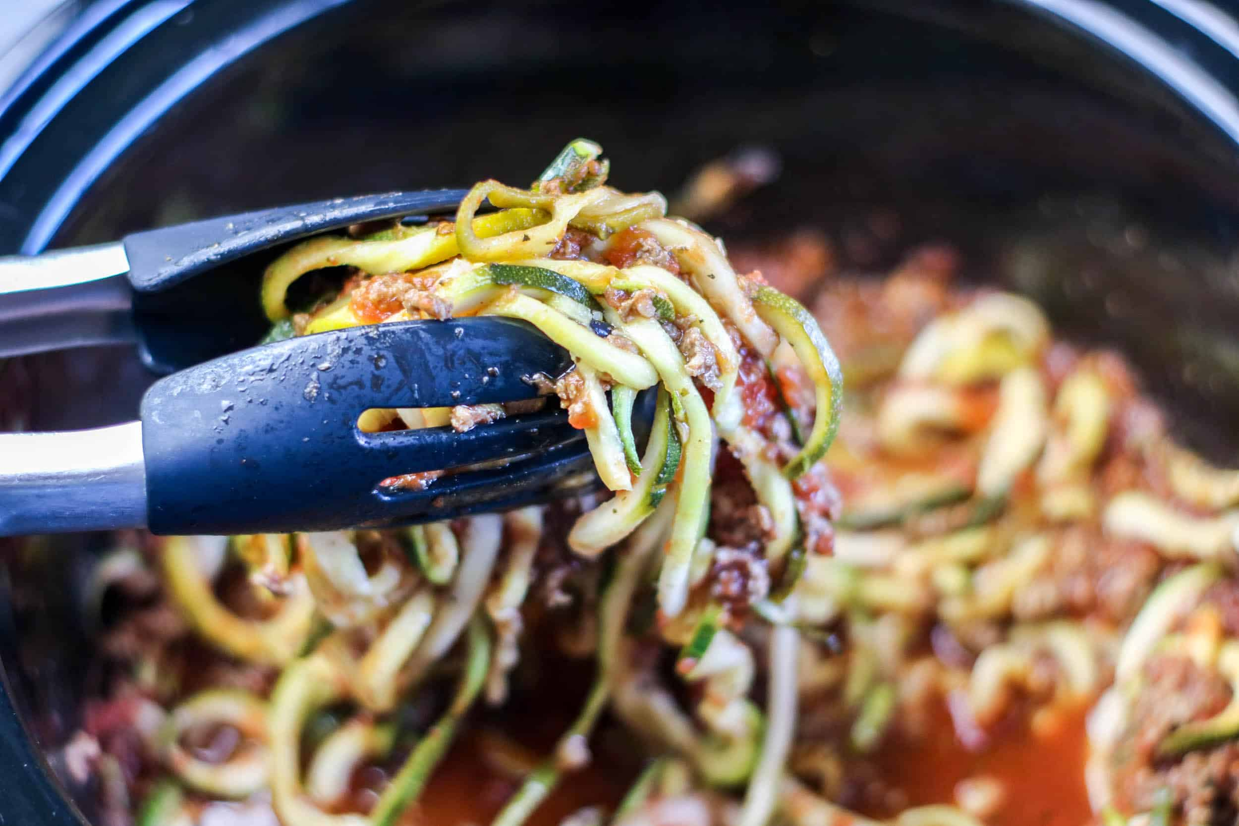 close up zoodles with meat sauce