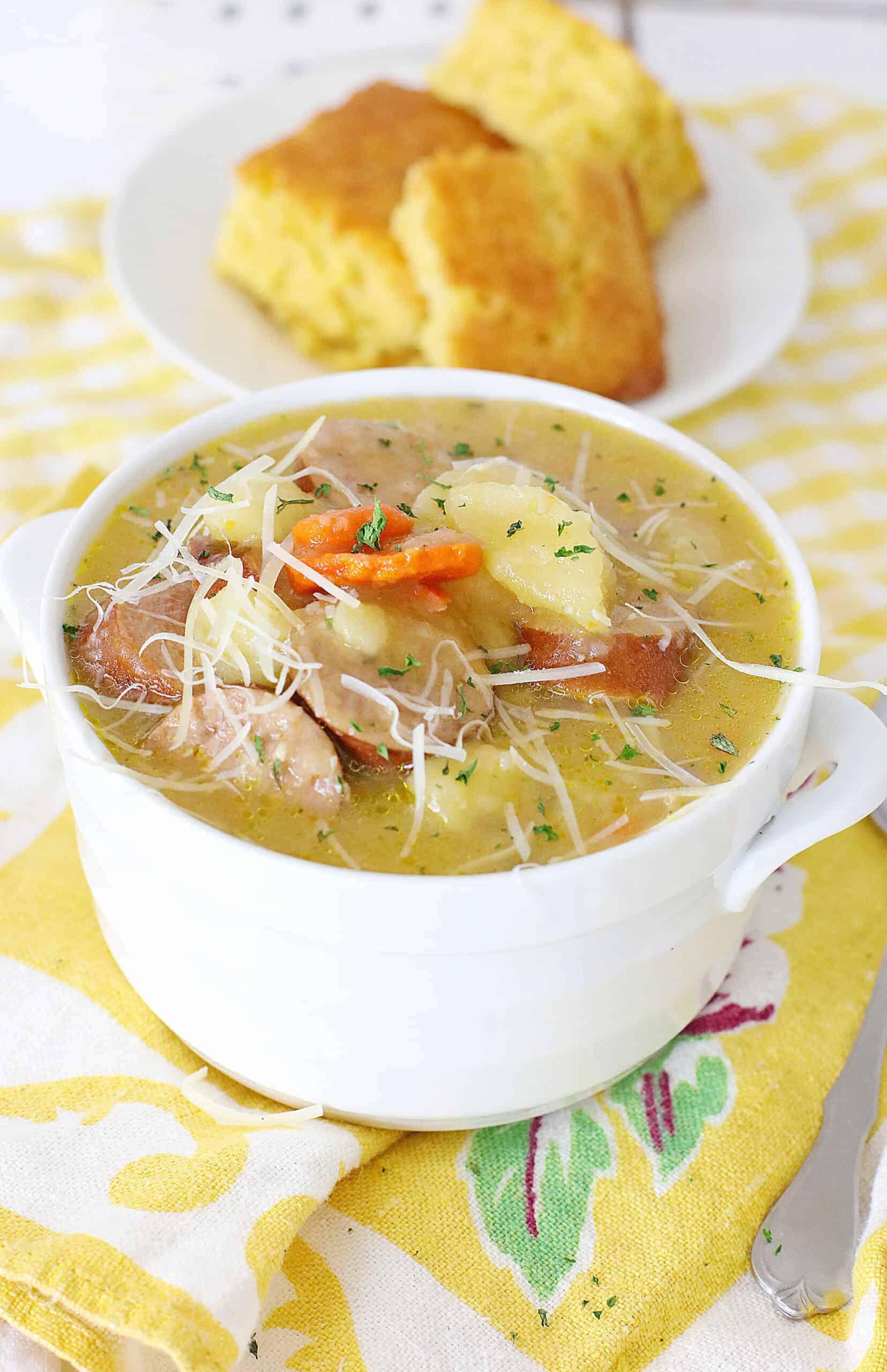 bowl of kielbasa soup and side of cornbread