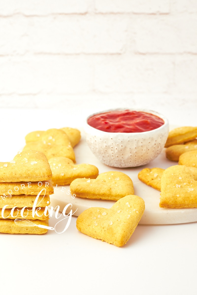 Olive oil crackers stacked with dipping sauce